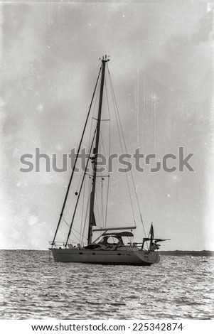 Yacht in the bay at anchor. Old retro photo. - stock photo
