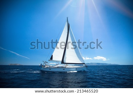 Yacht in the bright sunlight. Luxury yachts. - stock photo