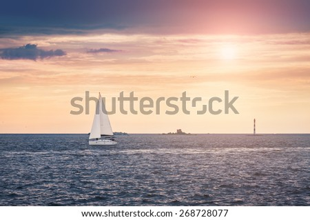 Yacht in the sea at sunset. Beautiful seascape. Creative toning effect