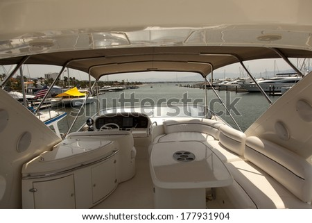 yacht marine equipment Instrument panel and steering wheel of a motor boat cockpit  - stock photo
