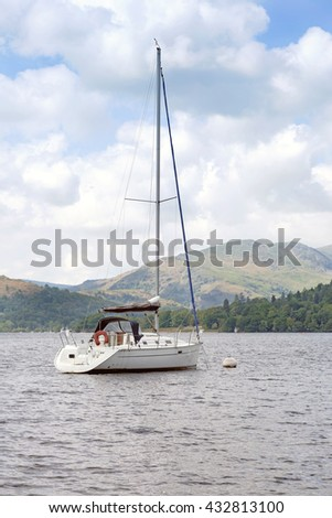 Yacht moored on Lake Windermere, Cumbria - stock photo