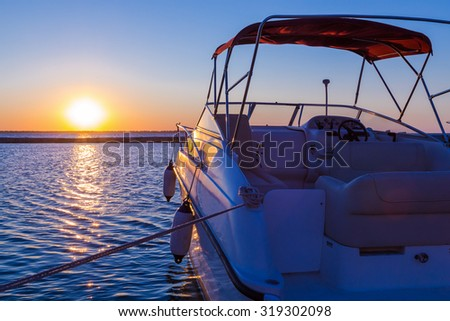 Yacht near the pier against sunset, summer vacation concept - stock photo