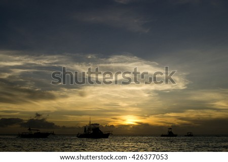 Yacht on sunset background