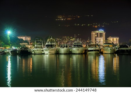Yacht on the sea pier at night - stock photo