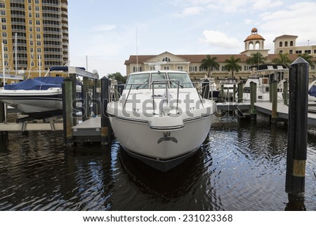 Yacht parked in the harbor in Cape Coral, wooden path, Florida - stock photo