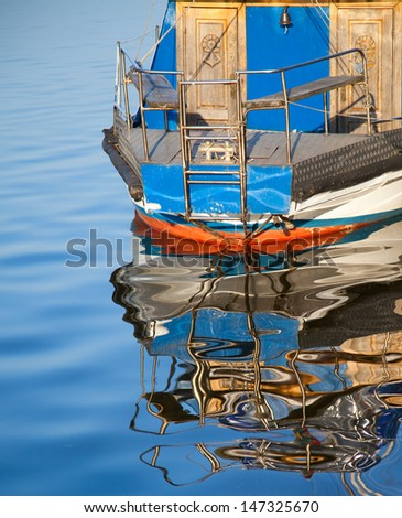 Yacht reflection - stock photo