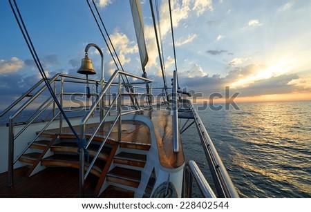 Yacht Sailing against sunset. Luxury yachts. - stock photo