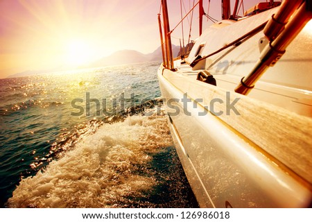 Yacht Sailing against sunset. Sailboat. Yachting. Sailing. Travel Concept. Vacation - stock photo