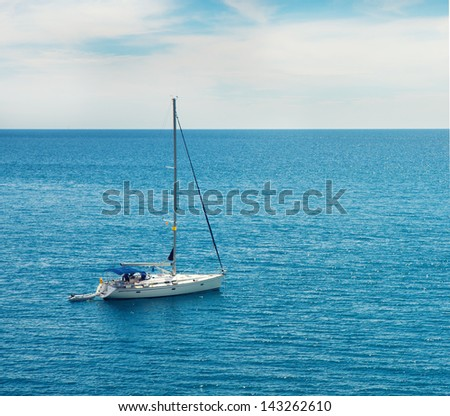 Yacht sailing in the ocean - stock photo