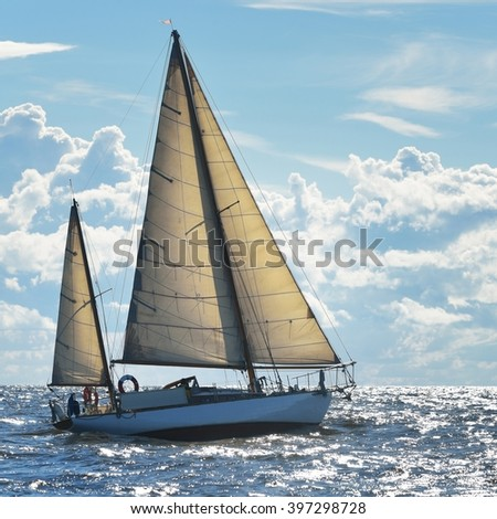 Yacht sailing on a sunny day in Riga bay - stock photo