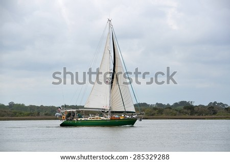 Yacht sailing on cloudy day on the river Florida, USA. - stock photo