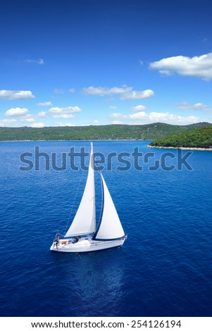 Yacht sailing on open sea at windy day - stock photo