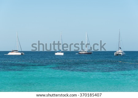 Yacht sailing on tropical sea at windy day