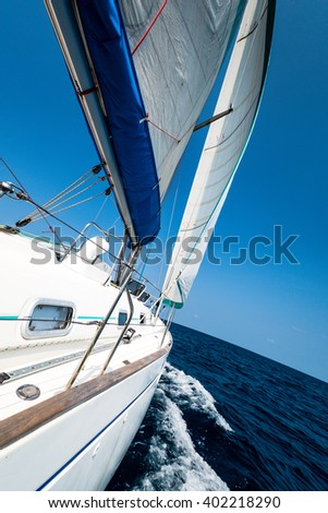 Yacht with sails in the open sea