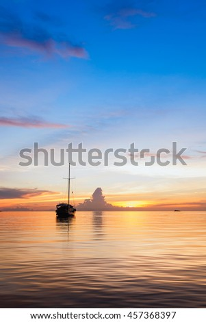 Yacht with sunset scene in koh phangan, Surat Thani, Thailand : selective focus on boat.