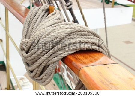 Yachting. Nautical thick ropes, nautical thick cord, rigging details on old sailboat - stock photo