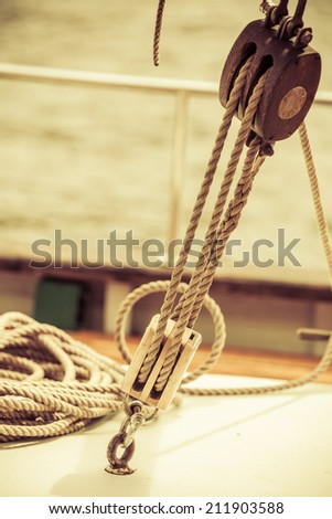 Yachting. Sailboat view of different parts of yacht, block with rope. Detail of a sailing boat - stock photo
