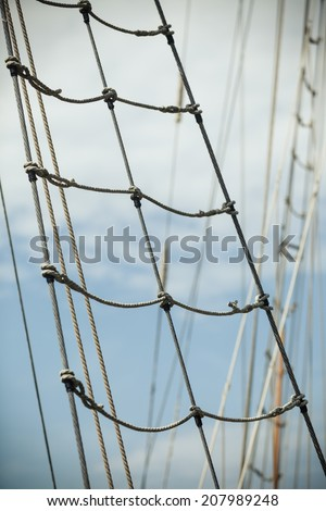 Yachting. Sailboat view of different parts of yacht. Mast wanta against blue summer sky - stock photo