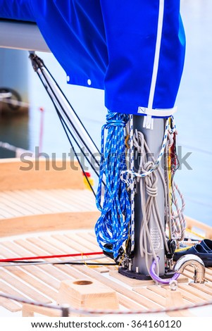 Yachting. Sailboat view of different parts of yacht, mast with rope. Detail of sailing boat - stock photo