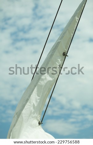 Yachting. Sailboat view of different parts of yacht, sail with rope. Detail of a sailing boat - stock photo