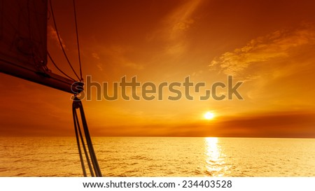 Yachting yacht sailboat sailing in baltic sea at sunset sunrise summer vacation. Tourism luxury lifestyle. - stock photo