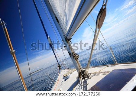 Yachting yacht sailboat sailing in baltic sea blue sky sunny day summer vacation. Tourism luxury lifestyle.