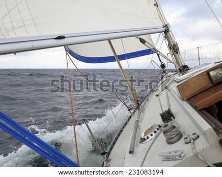 Yachting yacht sailboat sailing in baltic sea overcast sky summer vacation. Tourism luxury lifestyle. - stock photo