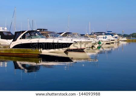 Yachts anchored at marina - stock photo