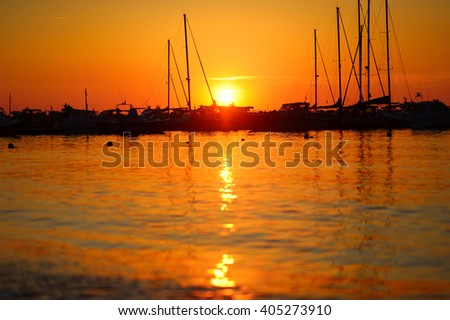 Yachts and boats at Adriatic sea bay at sunset in golden and pink tones in Salermo, Italy - stock photo