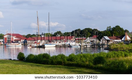 Yachts and boats in harbour of St Michaels on Chesapeake bay with heron - stock photo