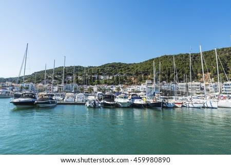 Yachts and sailboats docked at the marina in Estartit located in the Costa Brava, Girona, Catalonia, Spain - stock photo