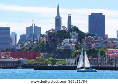 Yachts and San Francisco downtown skyscrapers - stock photo
