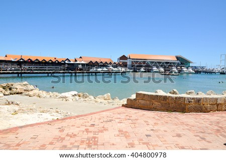 Yachts and tourists at Hillarys Boat Harbour in Hillarys,Western Australia/Harbour/HILLARYS,WA,AUSTRALIA-JANUARY 22,2016: Yachts and cove at Hillarys Boat Harbour in Hillarys,Western Australia. - stock photo