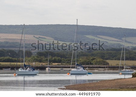 Yachts at anchor in a peaceful backwater