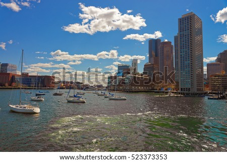 Yachts at Boston Wharf in Charles River and Financial district on the background, Boston, Massachusetts, the United States.