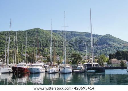 "Yachts at the pier. Tivat, Montenegro - 26 April, 2016. Regatta ""Russian stream"" in God-Katorskaya bay of the Adriatic Sea off the coast of Montenegro. - stock photo"