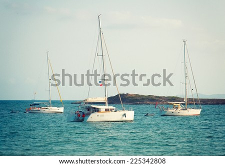 Yachts in the bay at anchor. - stock photo