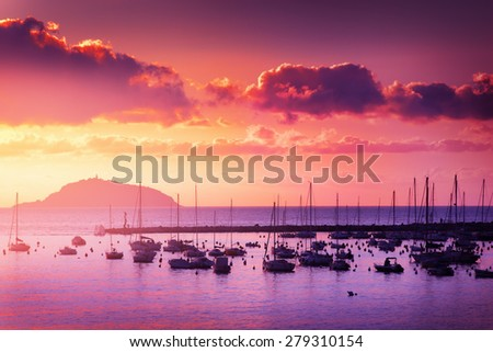 Yachts in the harbor. Scenic sunset over Mediterranean sea, Lerici, Italy. Color toning has been applied. - stock photo