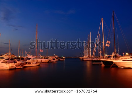 yachts in the marina at twilight - stock photo