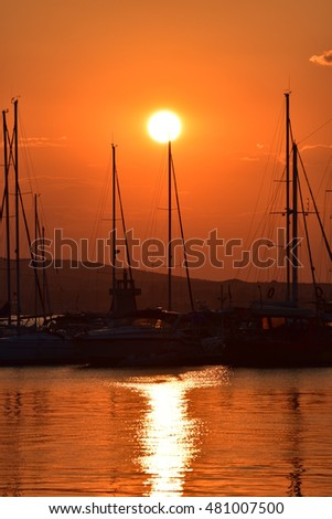 yachts in the port at sunset