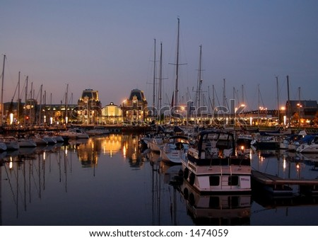 Yachts in the sunset - stock photo