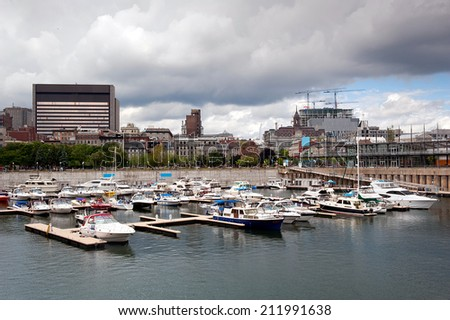 yachts moored in harbor at old port in Montreal - stock photo