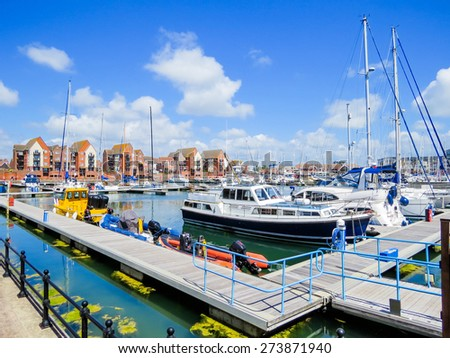 Yachts moored in the Sovereign Harbour Marina, Eastbourne, East Sussex, England (UK) - stock photo