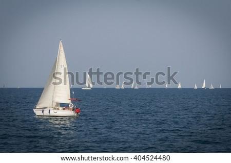 Yachts sailing in the Mediterranean sea next to the shore of Tel Aviv, Israel. November 2013. - stock photo