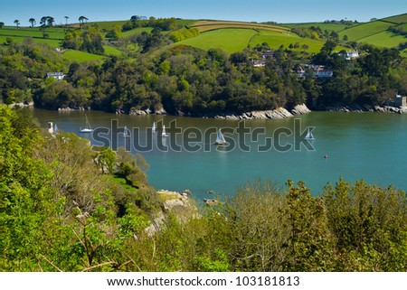 Yachts sailing on the River Dart near Dartmouth against the beautiful English coastline