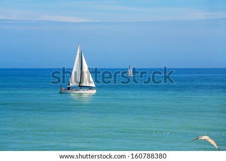 Yachts sailing on the sea. England - stock photo