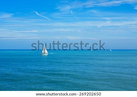 Yachts sailing on the sea. England, UK - stock photo