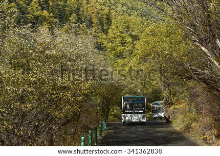 Yading, China - October 19, 2015: tourist on the bus in Yading national level reserve on October 19, 2015 in Yunnan, China.