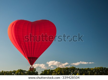 YAKHROMA, RUSSIA - JUNE 23, 2015: Flight on a balloon in the shape of a heart. - stock photo