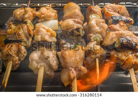 YAKITORI The barbecued  chicken Japanese food which I am cooking - stock photo